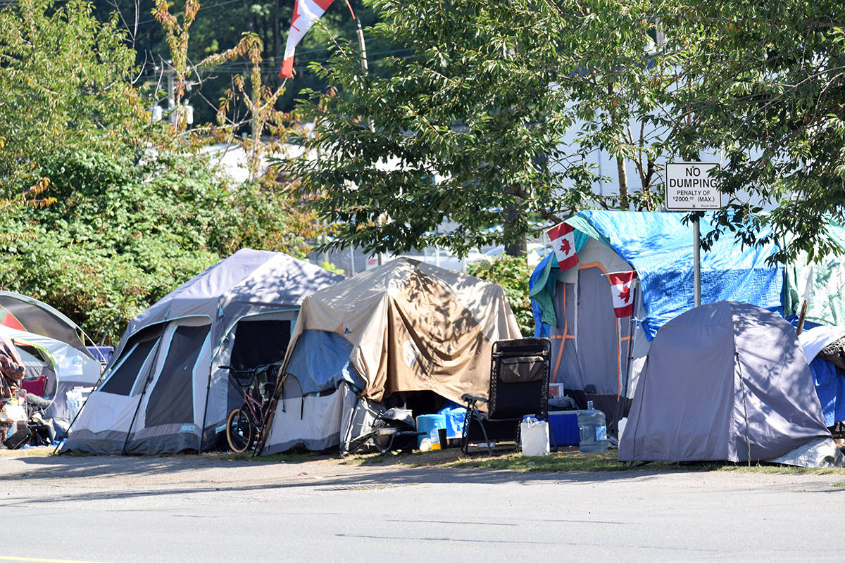 A homeless camp on Gladys Avenue in Abbotsford in 2013 is the subject of a complaint that will proceed to a hearing of the Human Rights Tribunal. (Abbotsford News file photo)