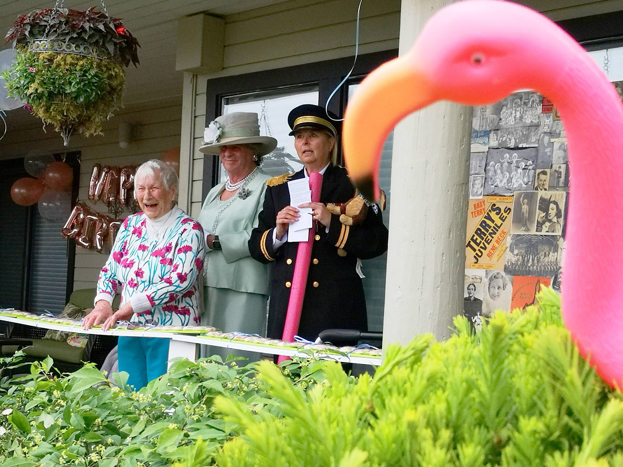 Dorothy McKilligan (centre) gets a surprise visit from 'The Queen' – played by son Andrew (and Prince Philip, played by daughter-in-law Thyra) during 100th birthday celebrations at her Nicowynd residence on May 20.(Tracy Holmes photo)