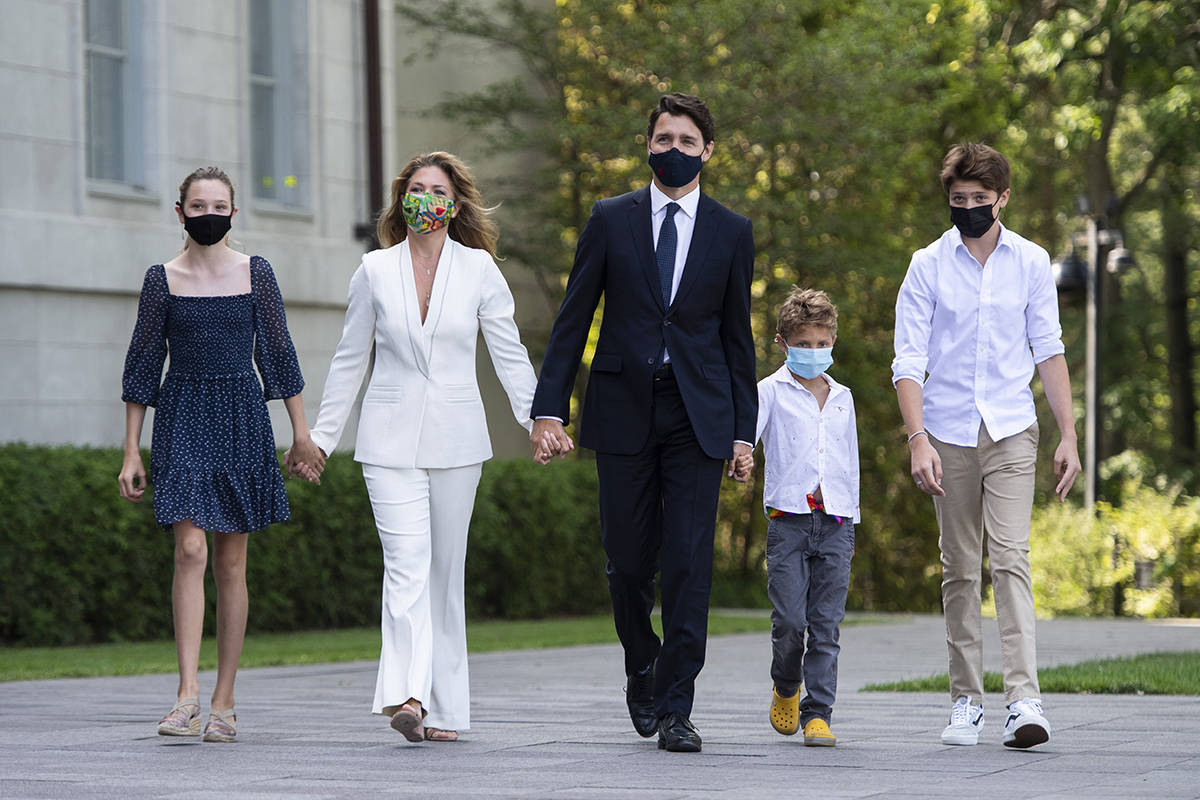 Prime Minister Justin Trudeau arrives with his wife Sophie Gregoire Trudeau and their children, from left to right, Ella-Grace, Hadrien and Xavier, to meet with Governor General Mary Simon at Rideau Hall in Ottawa, on Sunday, Aug. 15, 2021. THE CANADIAN PRESS/Justin Tang